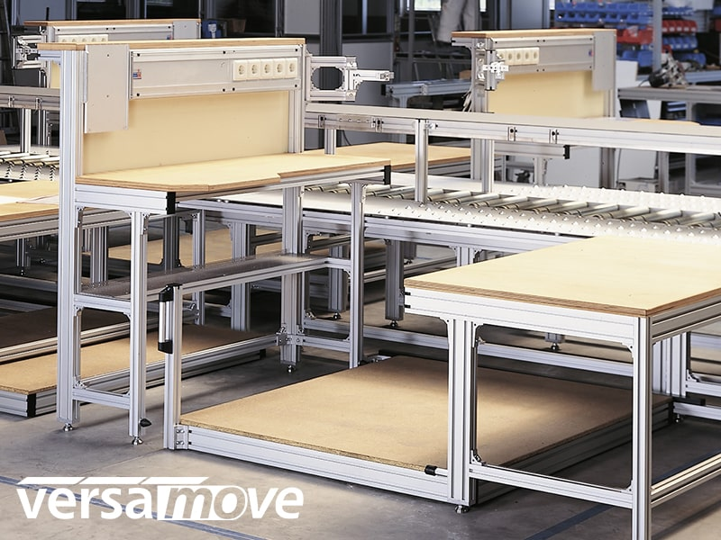 Pallet conveyor system with work benches in factory