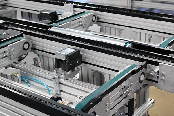 timing belt lift and transfers in a pallet-handling system